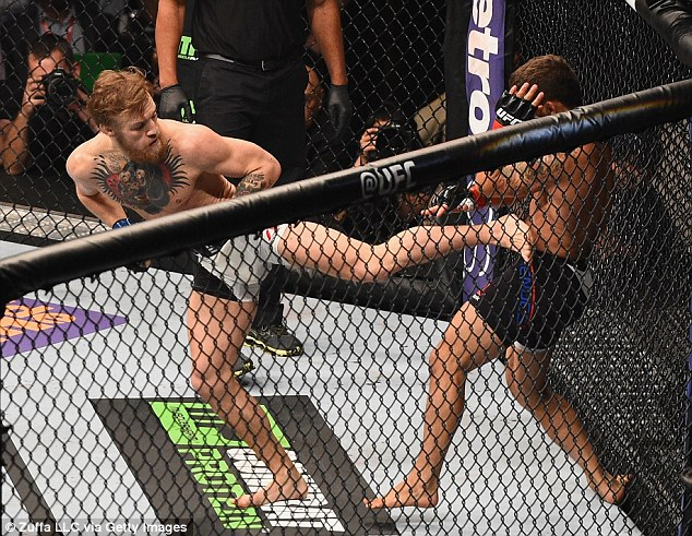McGregor lands a kick to the body as he hurt Mendes when they exchanged blows in the octagon