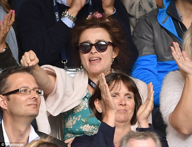 Tennis fan: Helena showed herself to be a big tennis fan as she cheered along on Centre Court