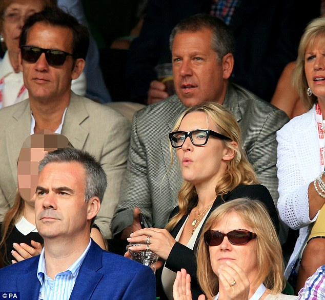 Rapt: The bespectacled 39 year-old was one of the many celebrities in attendance at the match between Novak Djokovic and Roger Federer, including Clive Owen