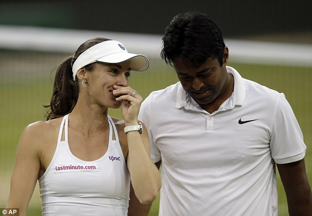 Hingis smiles with mixed doubles partner Paes as the duo clinched success in just 40 minutes