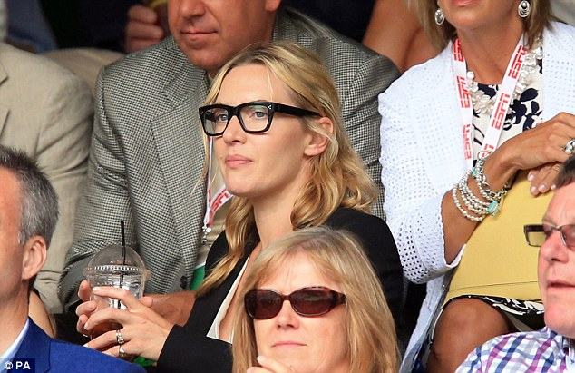 Loving it: Kate couldn't get enough of the high-powered action on Centre Court in the capital
