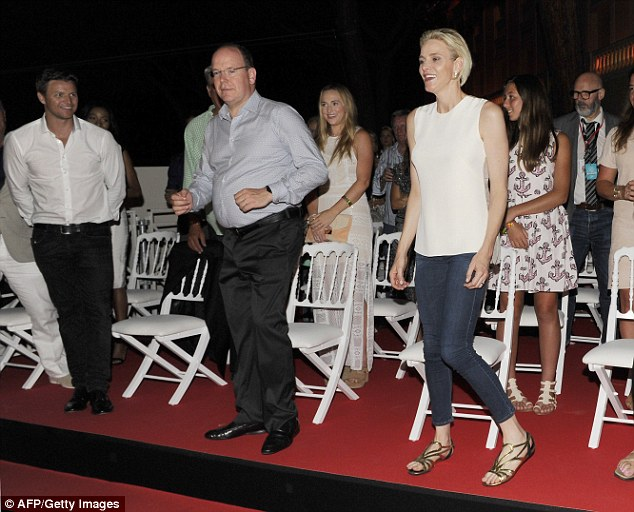 Dad dancing at its best! it would seem the royalty in attendance were most certainly amused, with Prince Albert getting up from his seat and indulging in a spot of dad dancing alongside wife Princess Charlene to Robbie's biggest tunes.