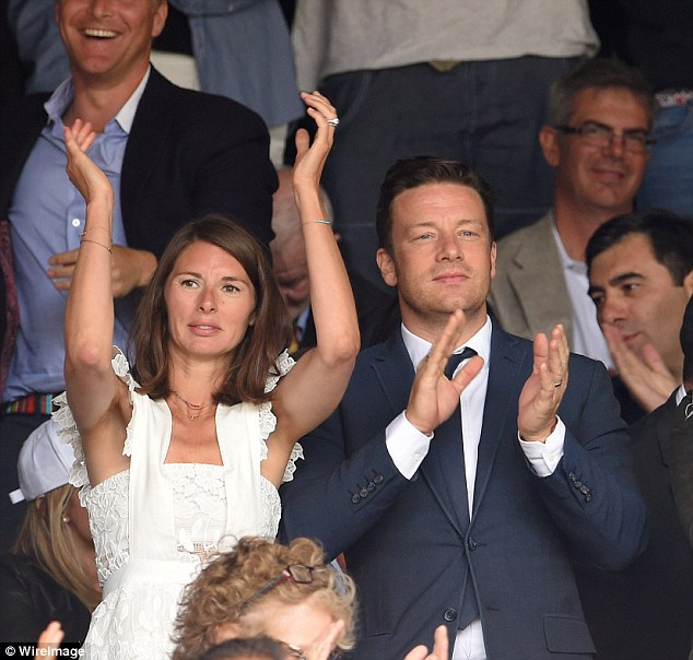 Well-dressed: Jools Oliver and Jamie Oliver wear synced styles as they attended the all-important game