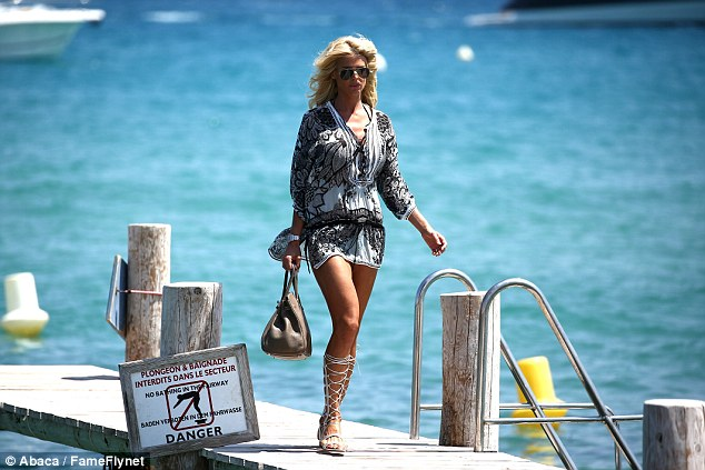 Work it: Victoria turned the jetty into her catwalk in her glam summer outfit