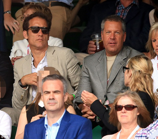 Famous friends: Handsome Clive Owen and Kate enjoy a catch-up between games on Sunday