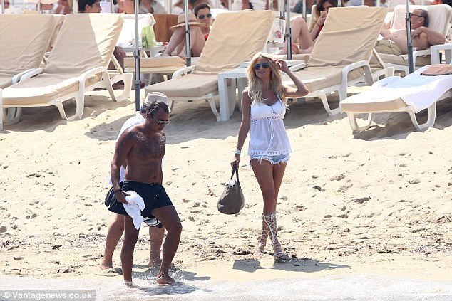 Sunshine break: Her favourite lace-up sandals were also back on as the blonde bombshell strolled along the coastline with her friends