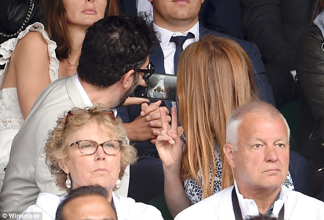 Selfie esteem: The popular couple capture their moment at the famous sports venue with a selfie