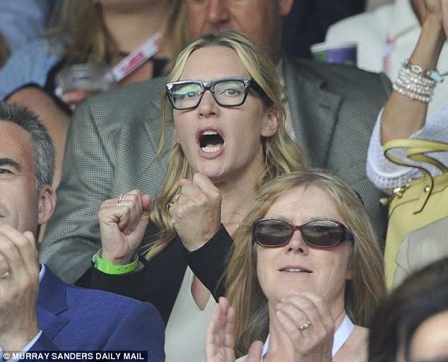 Come on! Kate clasps her fists as she watches Federer slowly lose his grip on the tennis title