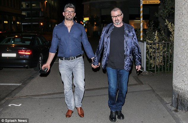 Fears: George Michael, pictured with his partner Fadi Fawaz, in Zurich, Switzerland, following claims he is battling a secret year-long addiction to crack cocaine