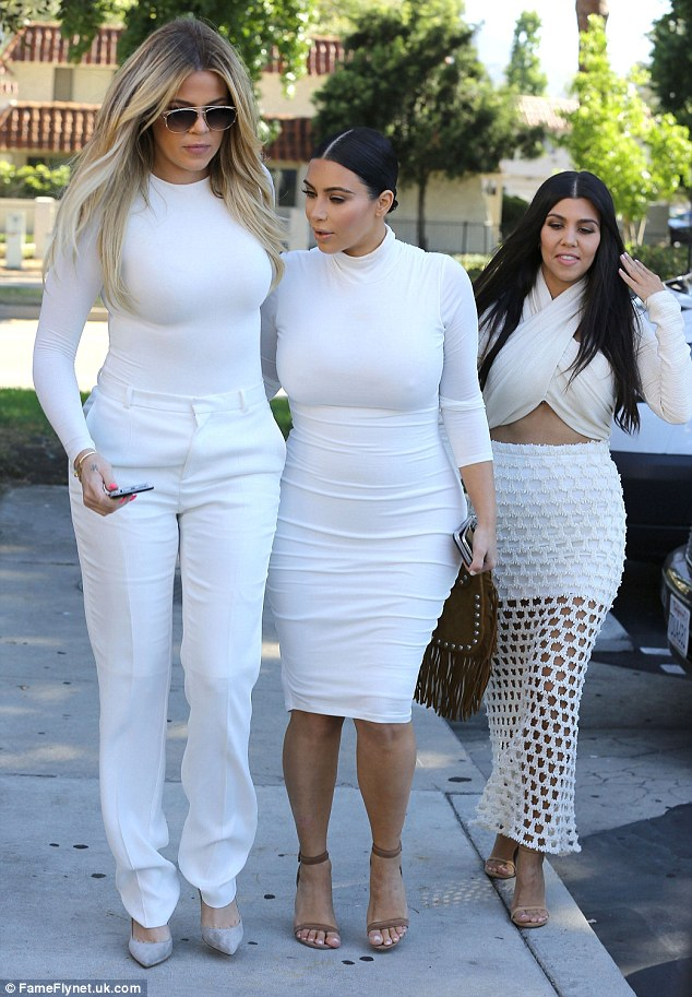 Famous family: Kourtney has been leaning on little sisters Kim and Khloe in the wake of the break-up. The trio are pictured on Tuesday, a day after it was revealed that Kourtney and Scott had split