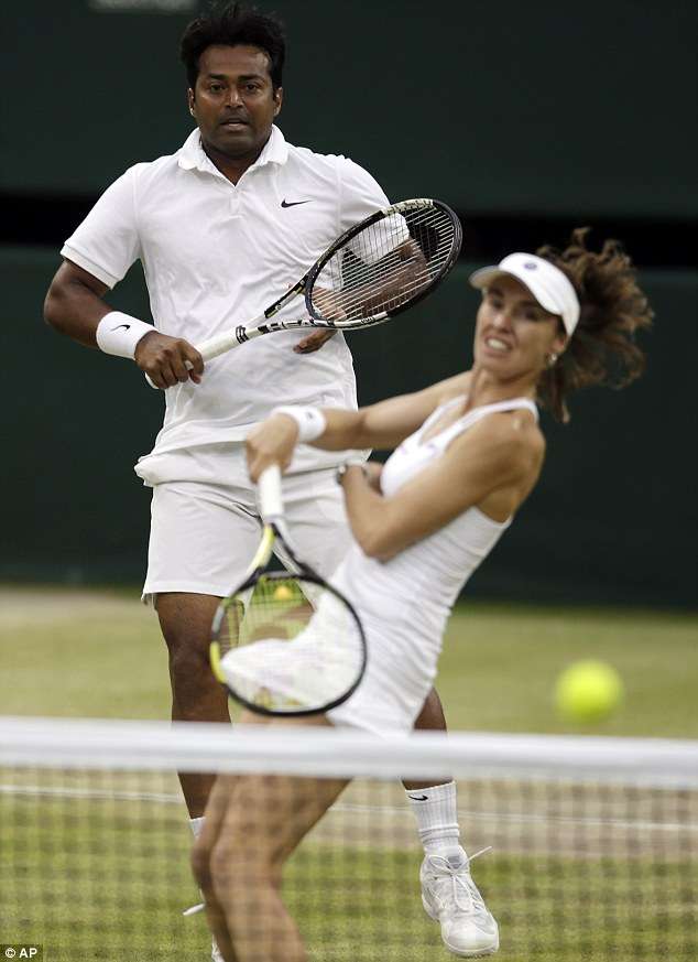 Hingis returns during the mixed doubles victory over Alexander Peya and Timea Babos on Centre Court