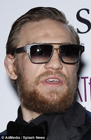 McGregor supports the cut next to his right eye which he sustained in the fight