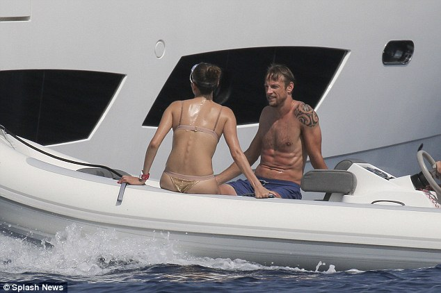 Picking up speed: The husband and wife, who marred in Hawaii in December, sped around on the waves during their break, which comes in the middle of a difficult Formula 1 season for Jenson