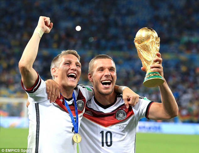 It is a year to the day on Monday that Podolski, pictured with Bastian Schweinsteiger, won the World Cup
