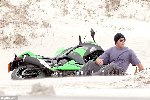 Crash course: Zac was also seen surrounded by beer bottles on the beach next to his motorbike