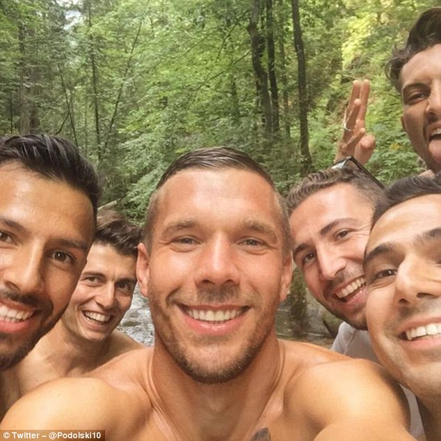 Lukas Podolski takes a selfie with his new Galatasaray teammates as the group enjoyed a bike trip