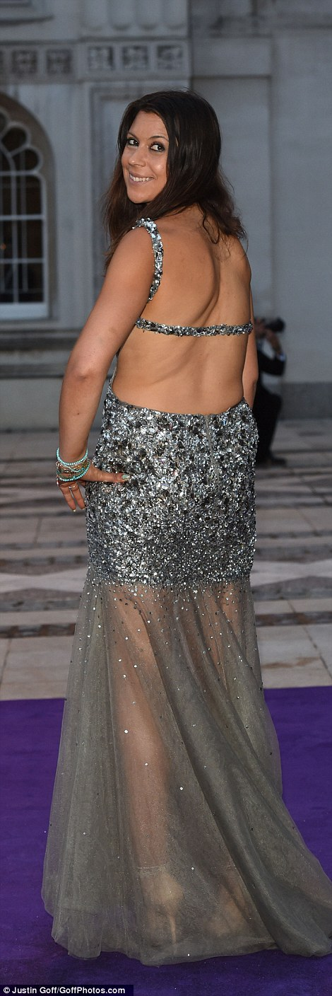 Wimbledon championMarion Bartoli sparkles in a backless silver sequinned number as she poses for pictures outside the Guildhall in London