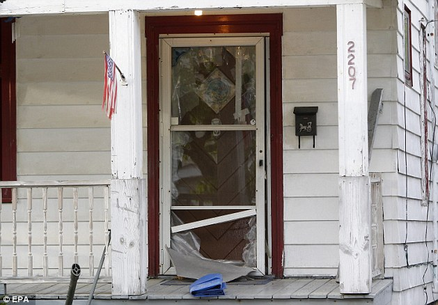 The broken front door of the house on Seymour Avenue in Cleveland Ohio where Amanda Berry kicked her way to freedom on May 6, 2013, more than a decade after she went missing