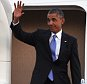 President Barack Obama waves as he arrives at Tinker Air Force Base, Wednesday, July 15, 2015, in Oklahoma City, Okla. (AP Photo/Tyler Drabek)