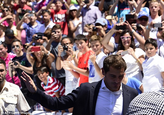 Casillas waves to supporters after his Monday press conference at the Santiago Bernabeu stadium