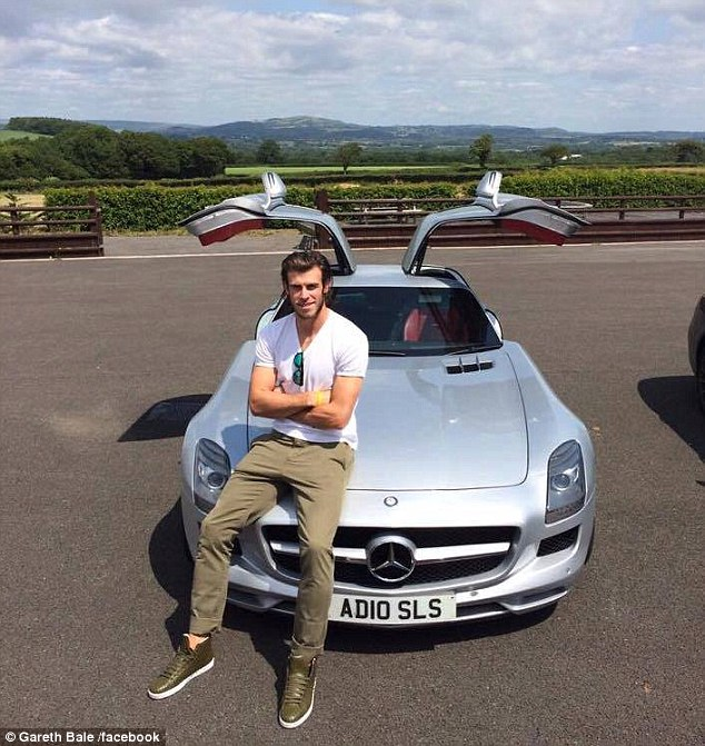 Gareth Bale poses for a photo with a Mercedes-Benz SLS AMG - a car Auto Vivendi gave him access too
