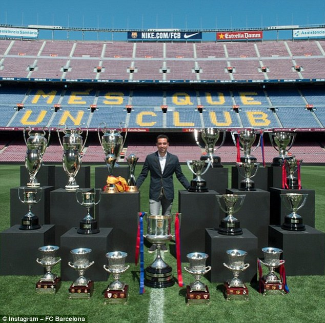 Barcelona great Xavi posed for a photo at the Nou Camp alongside all his trophies in a similar way to Casillas