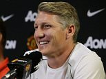 Manchester United manager Louis van Gaal, left, looks on as new signing Bastian Schweinsteiger speaks during a press conference, Wednesday, July 15, 2015, in Bellevue, Wash. Manchester United is in Seattle for an international friendly soccer match against Mexico's Club America to be played on Friday. (AP Photo/Ted S. Warren)