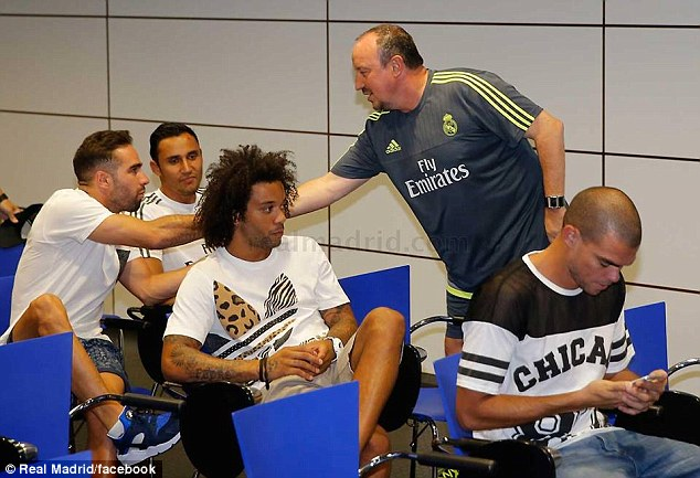 Benitez (second right) greets other members of the squad for the first time on Thursday at Real's training base
