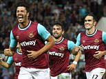 James Tomkins of West Ham United celebrates scoring the opening goal