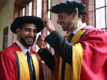 Boxer Amir Khan (left) with his cousin, England cricketer Sajid Mahmood in their gowns at Bolton University Victoria Hall before they received Honorary Degrees from Bolton University. PRESS ASSOCIATION Photo. Picture date: Wednesday July 15, 2015. Photo credit should read: Lynne Cameron/PA Wire