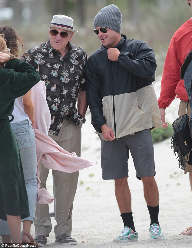 Family outing: Robert De Niro, who plays Dick Kelly, the Dirty Grandpa in question, turned up on the beach in a Hawaiian shirt, cream chinos and a natty hat