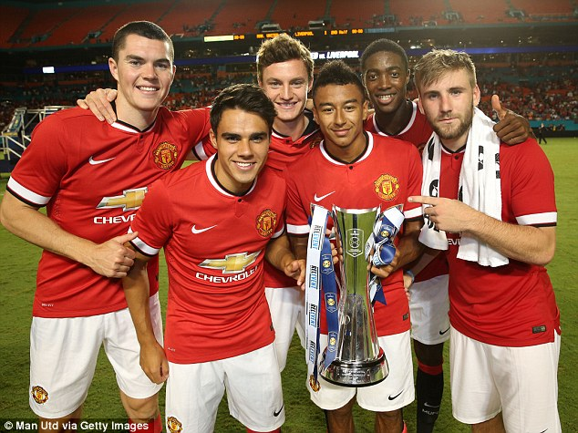 Shaw (right) helped United to the International Champions Cup trophy at Miami's Sun Life Stadium last August