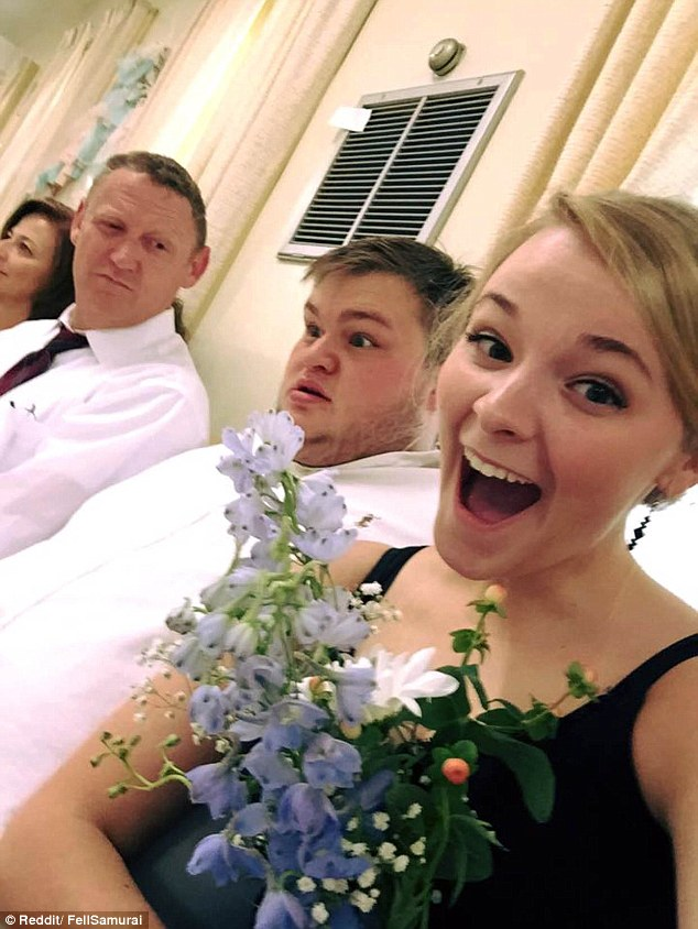 The photo: Ashley Stevens (R), 21, took this picture of herself, her boyfriend Christopher Reed (C) and her father (L) after catching the bouquet at a wedding, but when it was posted on Reddit, users insulted Christopher