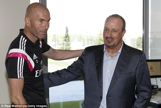 Zidane (left) greets Rafa Benitez upon his appointment as Madrid manager on a three-year deal