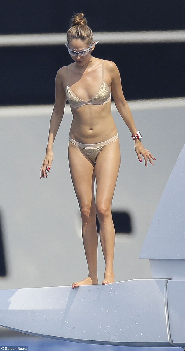 Making a splash:Jenson Button's wife Jessica Michibata looked gorgeous in a nude and gold bikini as the coupleenjoyed a day on board a luxury yacht off the South of France coast this week