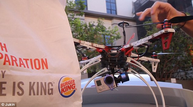 Fondly named the 'Whopper Dropper,' the device can be seen being loaded up with wrappes burgers before being flown around the parks and streets