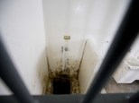 """This photo shows the shower area and opening to a tunnel, where authorities claim drug lord Joaquin """"El Chapo"""" Guzman, slipped into the tunnel to escape from his prison cell, at the Altiplano maximum security prison, in Almoloya, west of Mexico City, Wednesday, July 15, 2015. Experts have said the tunnel would have been more than a year in planning and building. The digging would have caused noise. The entrance was in a place beyond the view of security cameras at Mexico's toughest prison. They also said it was clear the escape by Mexico's most powerful drug lord must have involved inside help on a grand scale. (AP Photo/Eduardo Verdugo)"""