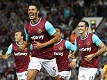 James Tomkins of West Ham United celebrates scoring the winning  goal