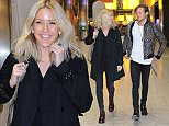 EXCLUSIVE: Ellie Goulding & Dougie Poynter fly into Heathrow Airport from Stockholm where Ellie has been working on her next album.  Pictured: Ellie Goulding,Dougie Poynter Ref: SPL1079943  150715   EXCLUSIVE Picture by: Steve Bagness/Splash News  Splash News and Pictures Los Angeles: 310-821-2666 New York: 212-619-2666 London: 870-934-2666 photodesk@splashnews.com