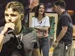 UK CLIENTS MUST CREDIT: AKM-GSI ONLY\nEXCLUSIVE: *SHOT ON 7/14/15** Calabasas, CA - Late Michael Jackson's son, Prince Jackson, appears to be developing into quite the ladies man.  He was spotted going to the movie theaters with a pretty brunette whose attention he fully stole.  Prince seemed to be in good spirits making the girl laugh as they talked before the movie.  He was seen smoking from what appeared to be a portable vaporizer which is used to smoke cannabis oil and seemed to be giggly while inside the theaters.\n\nPictured: Prince Jackson\nRef: SPL1080017  150715   EXCLUSIVE\nPicture by: AKM-GSI / Splash News\n\n