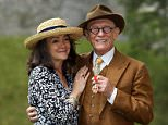 Sir John Hurt with his wife Anwen after being awarded a knighthood by Queen Elizabeth II during an Investiture ceremony at Windsor Castle. PRESS ASSOCIATION Photo. Picture date: Friday July 17, 2015. See PA story ROYAL Investiture. Photo credit should read: Steve Parsons/PA Wire
