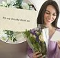 Young happy woman receiving flowers --- Image by © Tetra Images/Corbis
