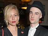 """LONDON, ENGLAND - APRIL 27:  Sienna Miller (L) and Tom Sturridge attend an after party following the press night performance of """"American Buffalo"""" at The National Cafe on April 27, 2015 in London, England.  (Photo by David M. Benett/Getty Images)"""