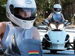 Picture Shows: Miley Cyrus  July 16, 2015\n \n Pop star Miley Cyrus is spotted out for a cruise on her three-wheeled motorcycle, a Can-Am Spyder, in Beverly Hills, California.\n \n Non Exclusive\n UK RIGHTS ONLY\n \n Pictures by : FameFlynet UK � 2015\n Tel : +44 (0)20 3551 5049\n Email : info@fameflynet.uk.com