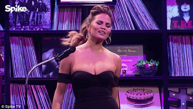 She's feeling it: Co-host Chrissy Teigen was spotted by the cameras singing along to the track