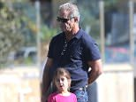 EXCLUSIVE TO INF. July 15, 2015: Mel Gibson & daughter Lucia Gibson spotted in Sydney hotel pool area, than taking a walk to a Sydney wharf, Sydney, Australia. Mandatory Credit: INFphoto.com Ref: infausy-12