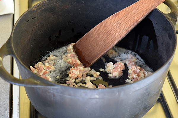 Pour oil in a pan and brown bacon bits for about 10 minutes over medium heat.