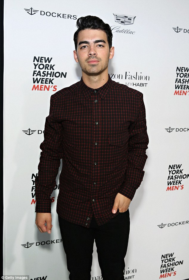 Cosy: Joe, pictured here at the Richard Chai fashion show, recently partied the night away with Gigi at a Pulp Fiction themed dinner in the Big Apple
