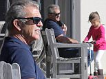 EXCLUSIVE TO INF.\nJuly 15, 2015: Mel Gibson & daughter Lucia Gibson spotted in Sydney hotel pool area, than taking a walk to a Sydney wharf, Sydney, Australia.\nMandatory Credit: INFphoto.com Ref: infausy-12