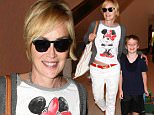Los Angeles, CA - Sharon Stone is all smiles as she makes her way through Los Angeles International Airport with her son.\n \n AKM-GSI July 17, 2015\n \n To License These Photos, Please Contact :\n \n Steve Ginsburg\n (310) 505-8447\n (323) 423-9397\n steve@akmgsi.com\n sales@akmgsi.com\n \n or\n \n Maria Buda\n (917) 242-1505\n mbuda@akmgsi.com\n ginsburgspalyinc@gmail.com